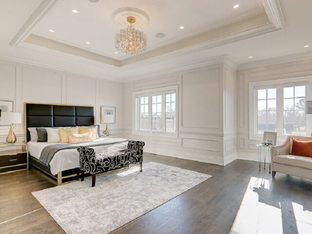 classic bedroom with crown moulding and coffered wall decor - custom home contractors