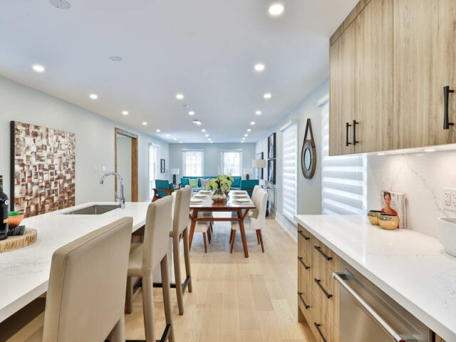 modern kitchen and dining room in custom home toronto