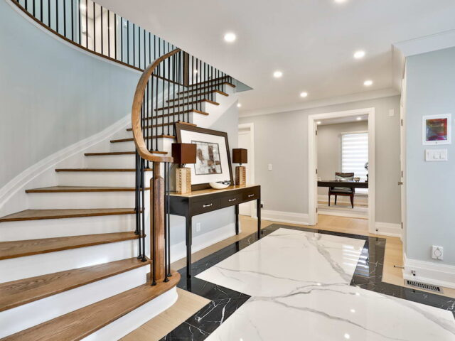classic staircase hallway with crown moulding and baseboard trim - toronto custom home builder
