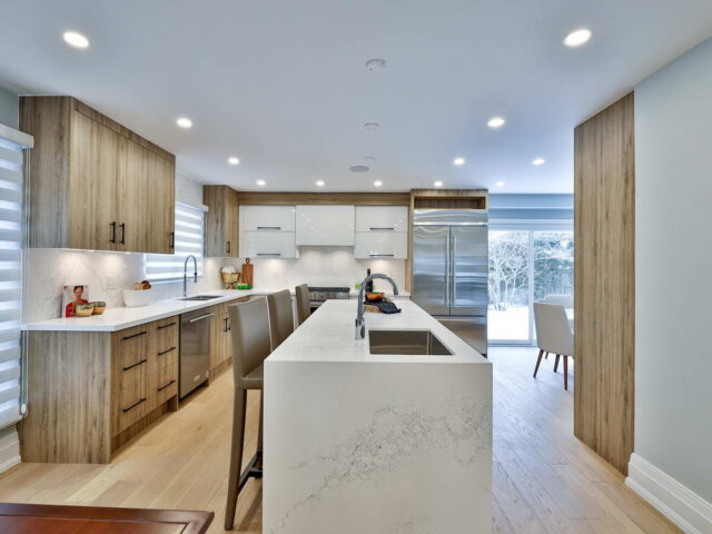 amazing kitchen with two tone brown and white kitchen cabinets - custom homes