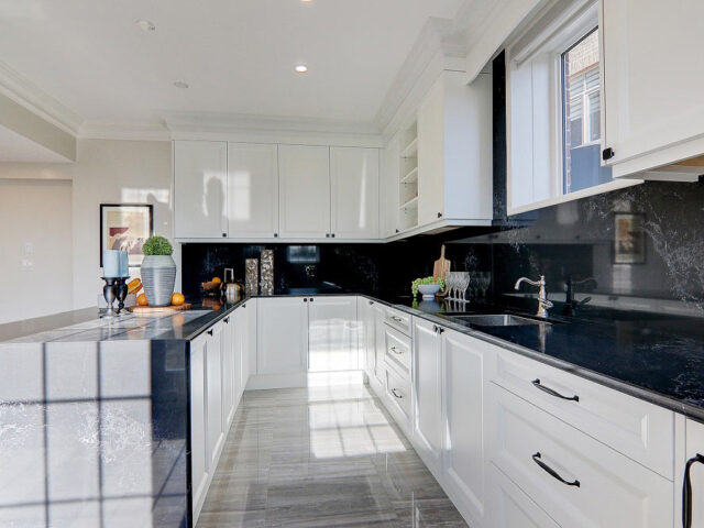 modern two tone black and white kitchen - custom home contractor