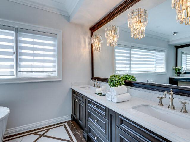 luxury bathroom with crown moulding and freestanding bathtub - custom homes