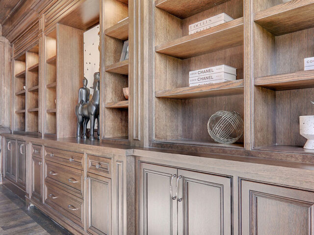 custom wooden backlit cabinets and shelves in home office build by Torino Construction