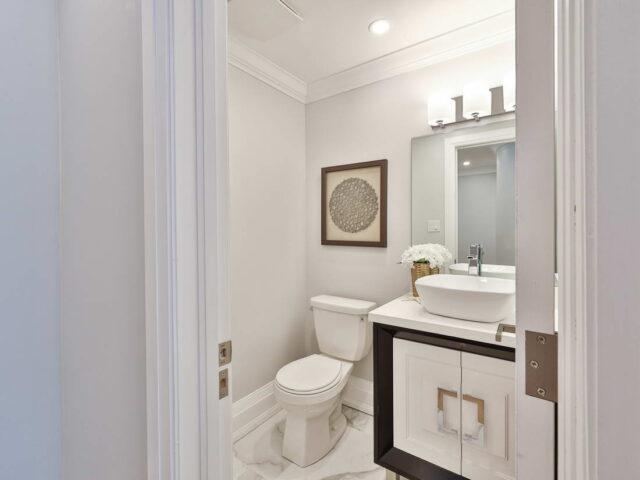 custom small bathroom with crown moudling - custom homes