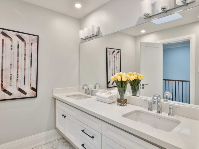 double sink and large mirror in custom bathroom by torino construction