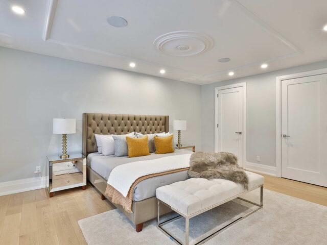 modern bedroom with custom interior doors - custom home builders