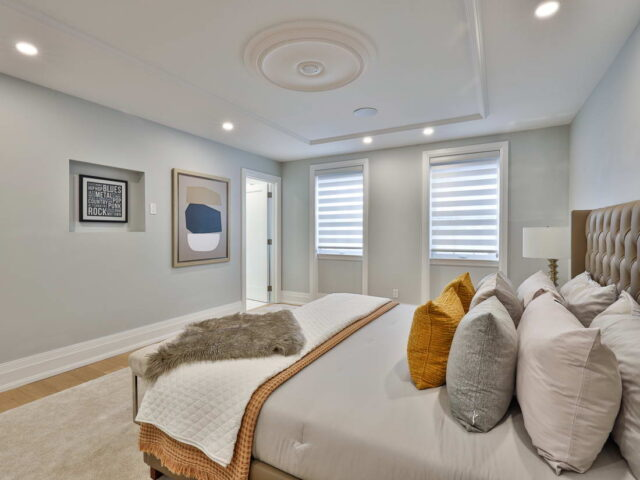 amazing master bedroom with window decor and baseboard trim