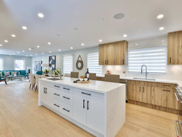 modern kitchen with kitchen island and marble counter top - modern custom homes