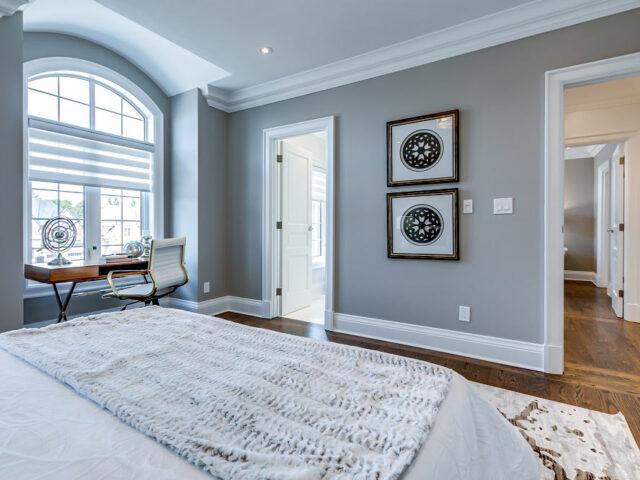 master bedroom with custom interior doors - custom home experts