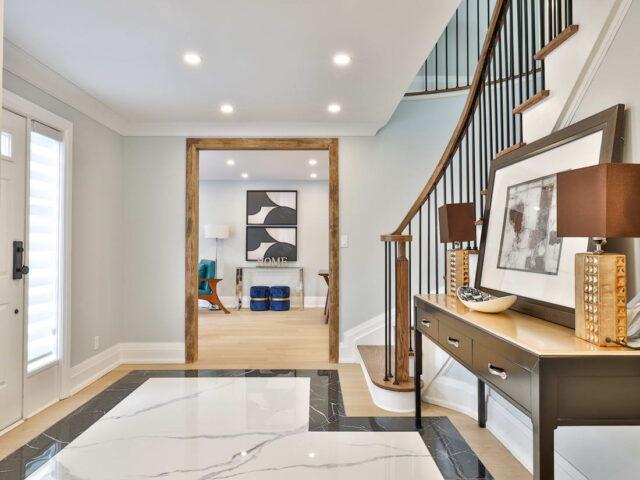 front door hallway with baseboard trim - custom home contractor