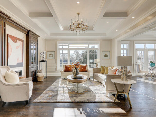luxury family room with baseboard trim and crown moulding - toronto custom home builder