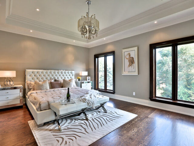 amazing bedroom with gray wall paint and crown moduling by torino construction