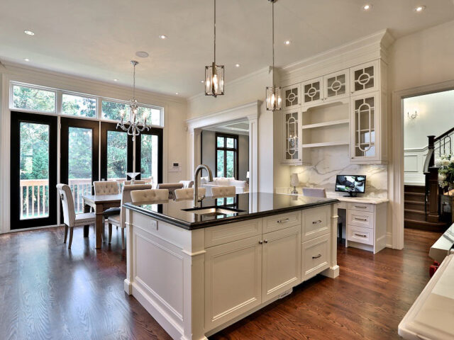 luxury kitchen with white kitchen cabinets and crown moulding trim - custom home experts