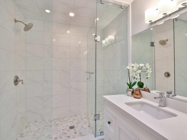 luxury bathroom with glass shower enclose - custom homes