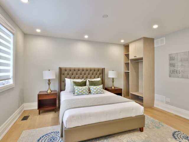 modern bedroom with cabinets and luxury bed