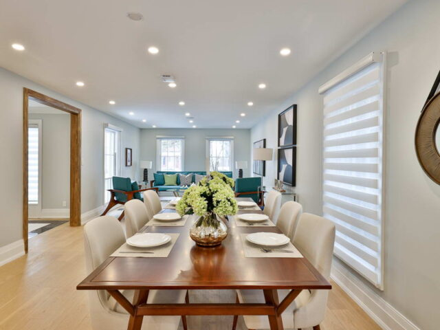 custom dining room with wooden table and baseboard trim - custom homes by torino construction