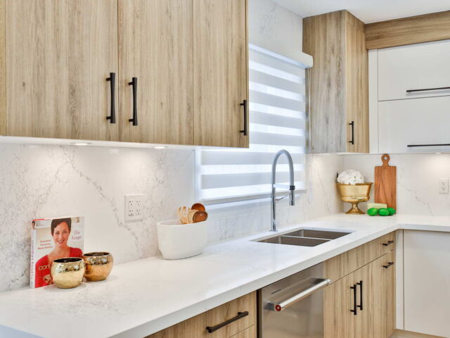 marble counter top and backlit kitchen cabinets in custom kitchen by torino construction