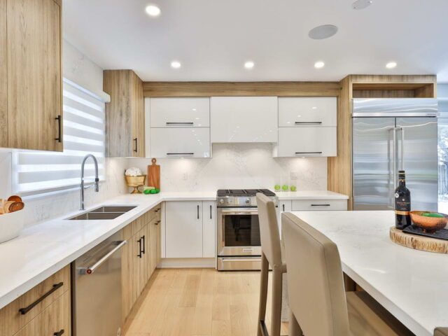 custom kitchen with marble counter top and wooden floor - custom homes contractor