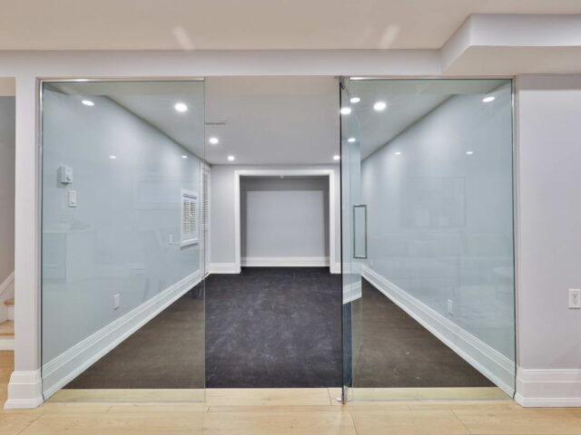 custom basement with glass door and enclose room - custom home experts