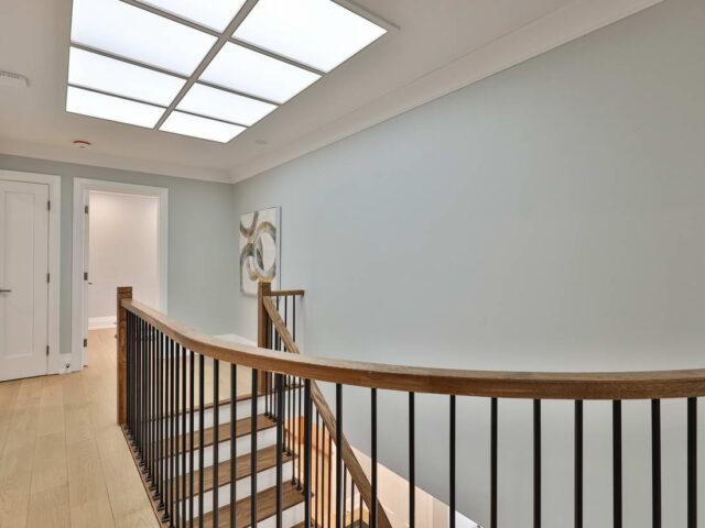 custom staircase with wooden railings - toronto custom home builders