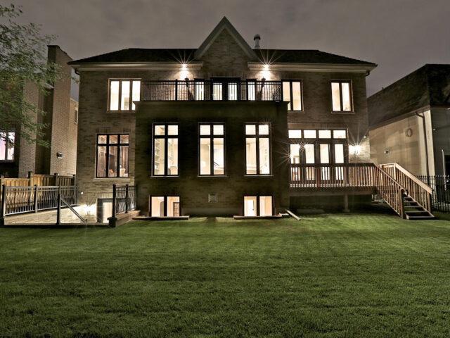 luxury custom home at night - custom home builders