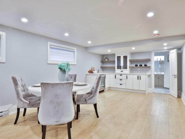basement kitchen with small mini fridge by torino construction