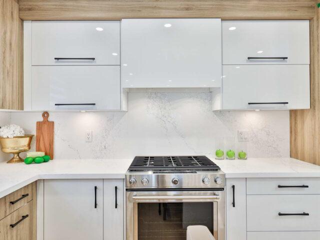 custom high gloss white kitchen cabinets in custom kitchen - custom homes