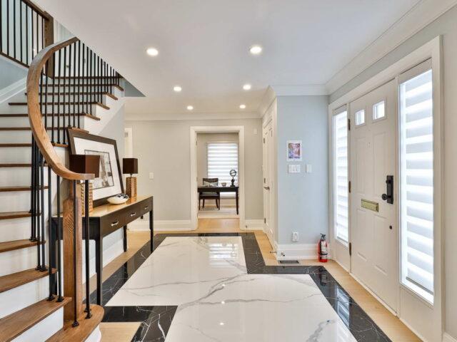 front door hallway with staircase to second floor - custom home builders toronto