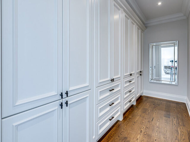 custom changing room with build in cabinets - custom home by torino construction