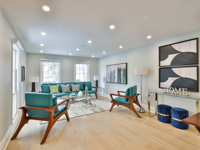 amazing family room with wooden floor and baseboard trim - toronto custom home builders