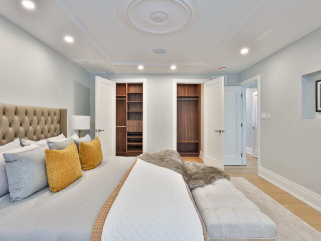 classic bedroom with build in closet - custom home builders toronto