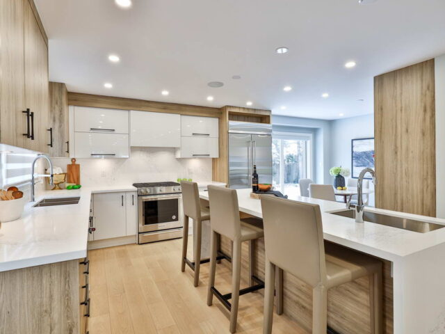 amazing kitchen with white glossy kitchen cabinets by torino construction
