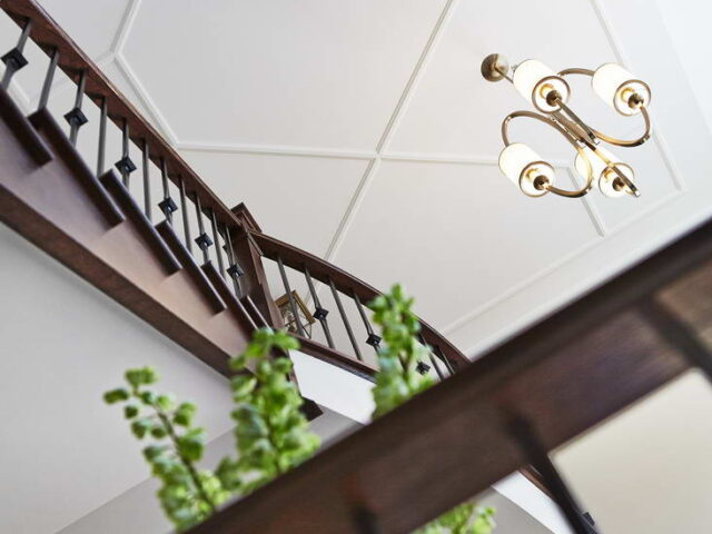 Amazing Staircase with Wooden Railings - Custom Homes