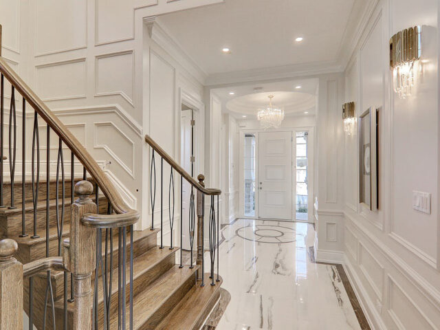 amazing staircase with coffered wall decor - custom home experts