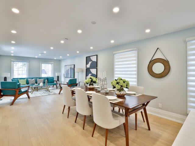luxury dining room with baseboard trim - custom home builders