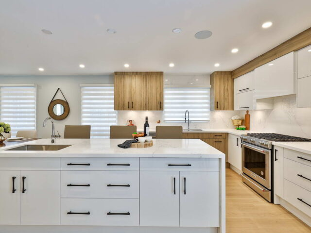 amazing kitchen island with build in kitchen cabinets - custom home contractor