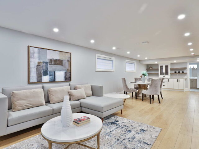open space basement with living room and dining room by torino construction toronto