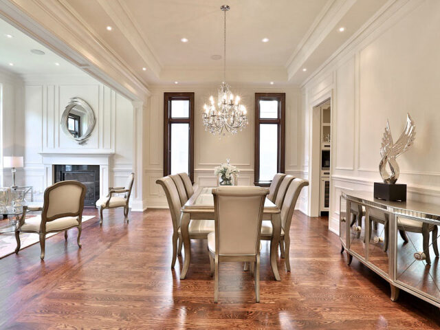 classic dining room with coffered wall decor - custom home contractor