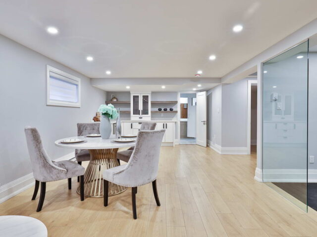 modern basement with small kitchen and dining area - custom homes
