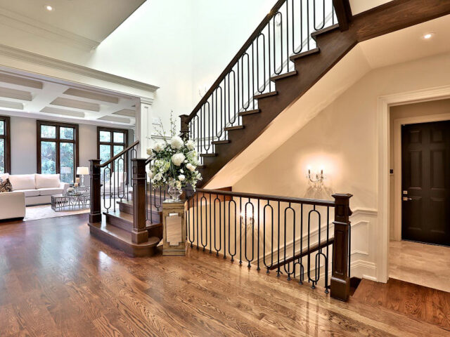 amazing staircase hallway with wainscoting décor