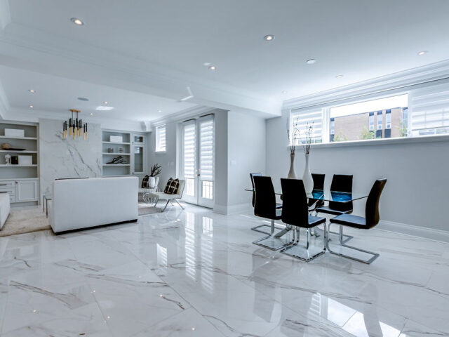 luxury basement family room with marble wall decor build by Torino Construction