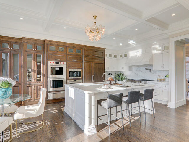 modern kitchen with waffle ceiling and build in appliances