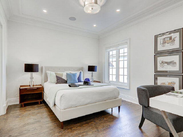 modern bedroom with baseboard trim and crown moudling - custom home experts