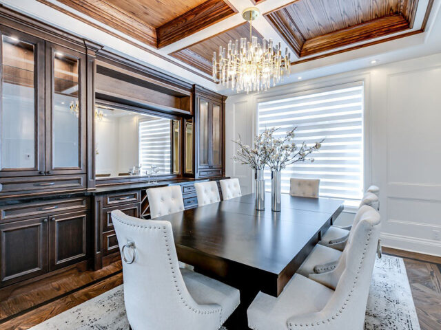 classic dining room with backlit cabinets and waffle ceiling - custom home experts