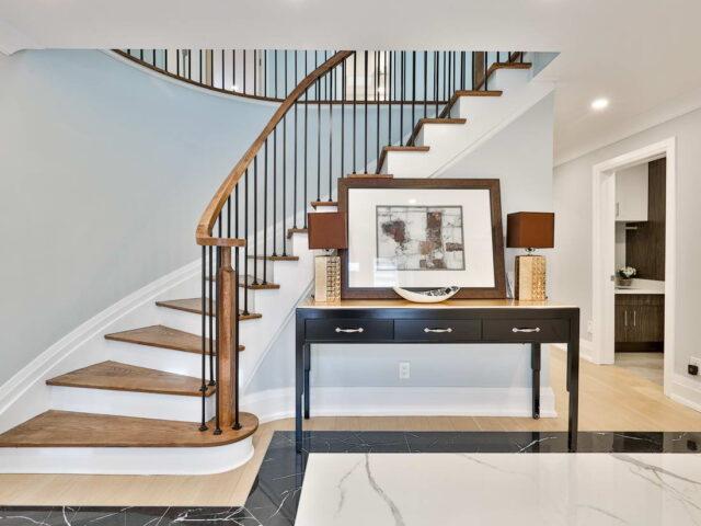 custom staircase with wooden railings - custom homes