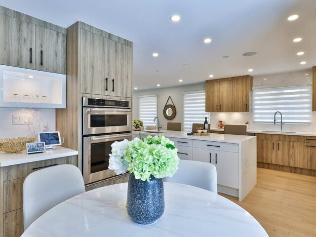 classic kitchen with glass kitchen cabinets doors by torino construction