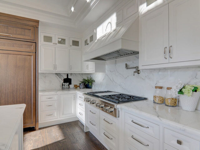 amazing kitchen cabinets and marble splash wall in custom kitchen by Tornio construction