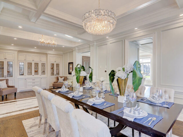 luxury dining room with waffle ceiling and crown moduling decor build by Torino construction