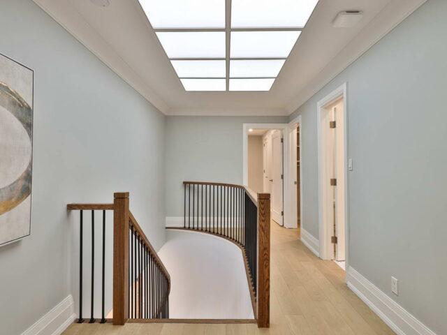 second floor hallway with custom doors - custom homes