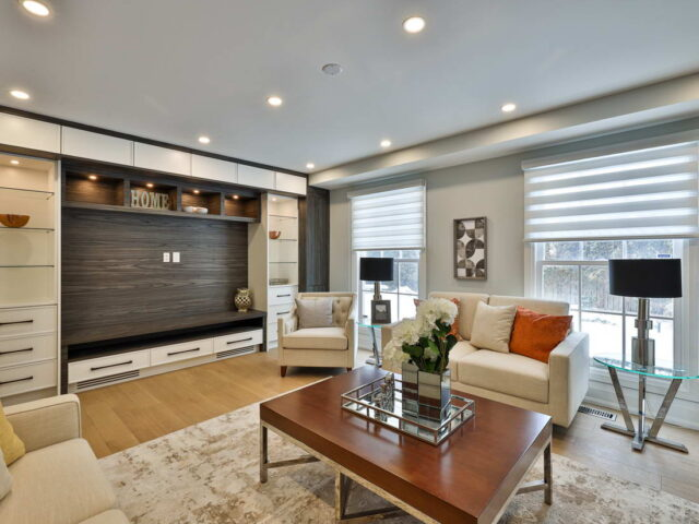 modern living room with entertainment unit and carpet - custom home contractor